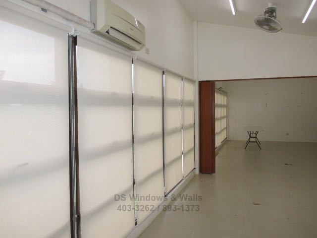 Roller shades with fully opened folding door